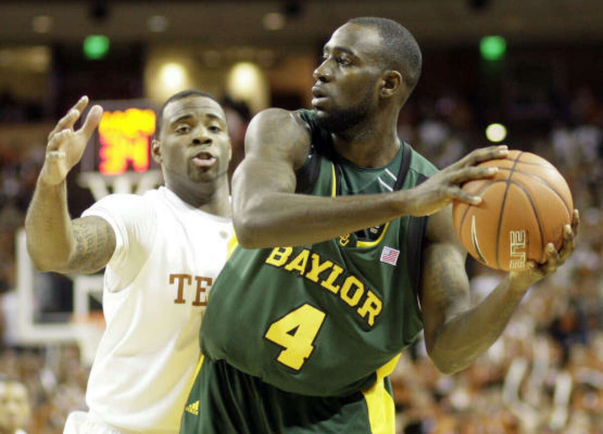 Texas forward Damion James, left, tries to put a clamp on Baylor forward Quincy Acy during the second half.