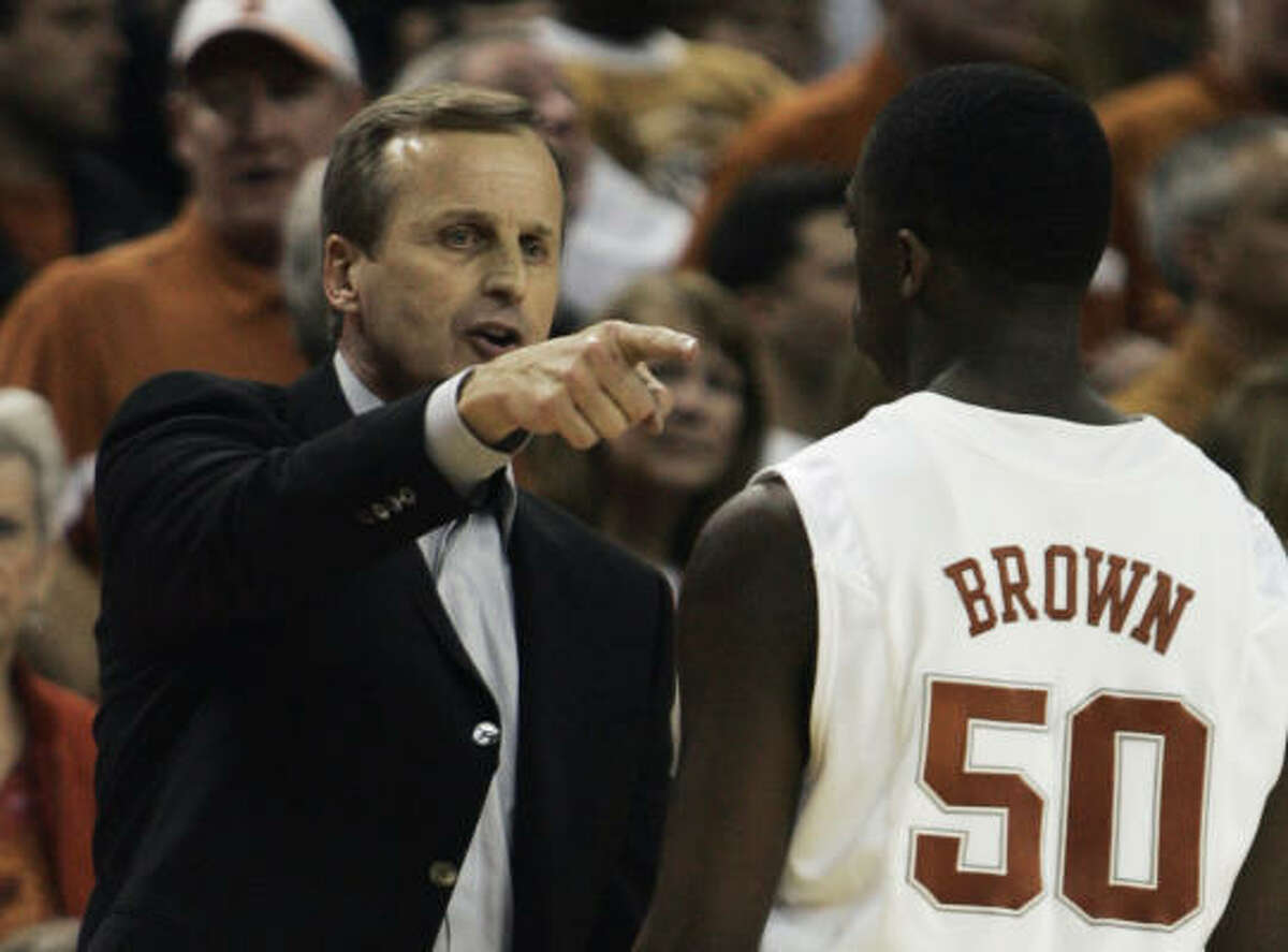 Texas coach Rick Barnes, left, gives instructions to guard J'Covan Brown during the second half.
