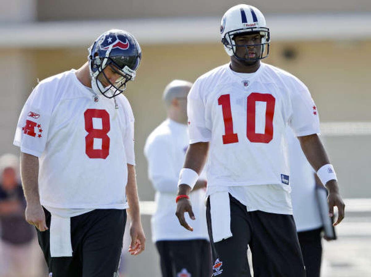 Texans quarterback Matt Schaub, left, and Tennessee Titans quarterback Vince Young talk during AFC practice.