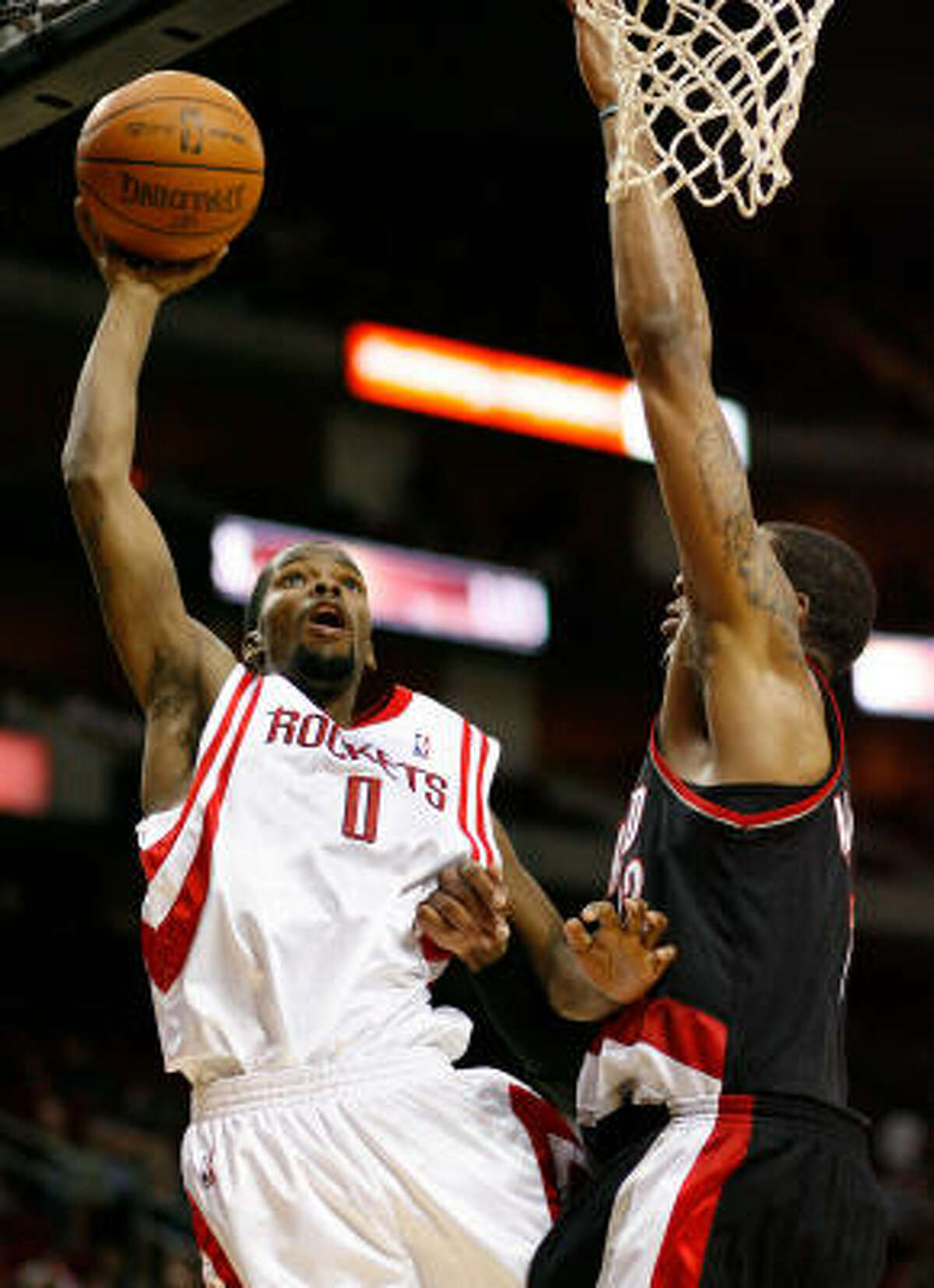 Rockets guard Aaron Brooks (0) scored a game-high 33 points to lead Houston to a 104-100 win over the Portland Trail Blazers on Friday night at Toyota Center.