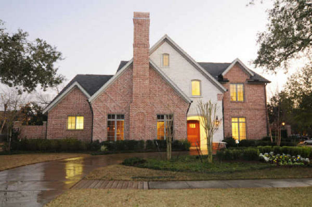 This West University Place home sits on a 14,000 sq. ft. corner lot, has a three-car garage and a circular driveway.