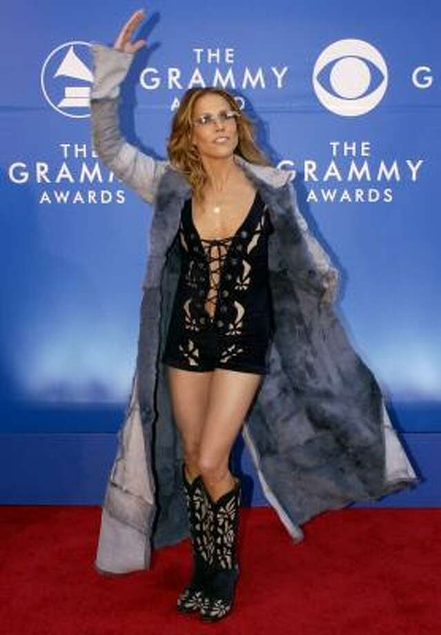 Sheryl Crow's outfit at the 2002 Grammy Awards screams red carpet disaster. Take a look at other celebrities who took fashion risks and failed miserably. Photo: MARK J. TERRILL, AP