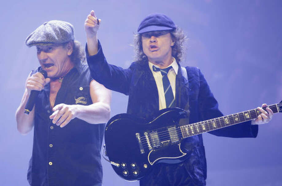 AC/DC- How long can you get away with wearing a schoolboy uniform onstage? Apparently all the way into retirement. Angus Young may be past his duck-walking prime, but the band that pioneered heavy metal has continued to do their dirty deeds since 1973. Photo: Mayra Beltran, Houston Chronicle