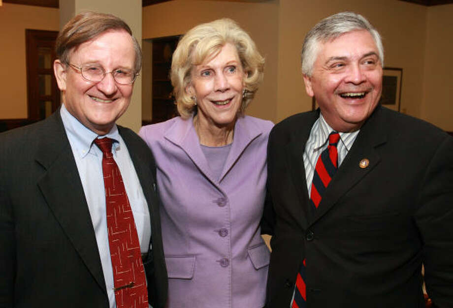 "Bill Glick, dean of Rice University's Jones School of Business, left, with Judy Allen and Henry Hernandez at a reception before the screening of the natural gas shale documentary ""Haynesville."" Photo: Gary Fountain, For The Chronicle"