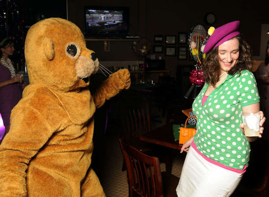 "Cynthia Conner, at right, dances with the gopher, a.k.a. Jenni Rebecca Stephenson at the ""Be the Ball"" annual benefit supporting Glasstire and Fresh Arts Coalition at the Hermann Park Golf Course. Photo: Dave Rossman, For The Chronicle"