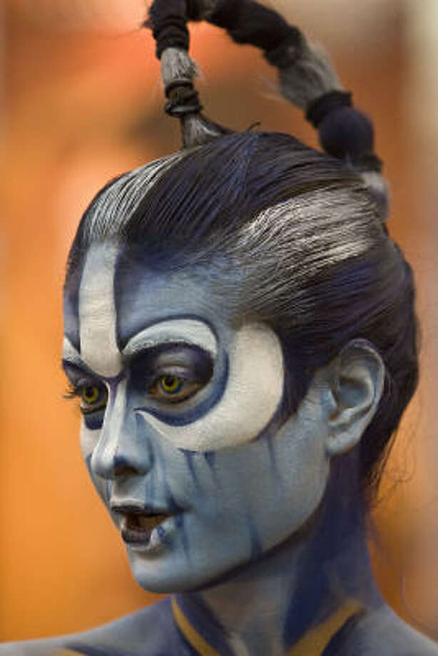 Sindy Perez is painted to resemble a character from the movie Avatar during the Halloween & Party Expo at George R. Brown Convention Center, in Houston. Photo: James Nielsen, Chronicle