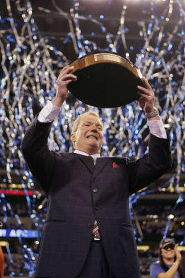Colts owner Jim Irsay holds the Lamar Hunt Trophy after the 30-17 win. The Colts will play in their second Super Bowl in four years. Photo: Mark Duncan, AP