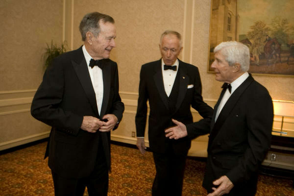 President George H.W. Bush, left, jokes with Denton Cooley, center, and Robert Mosbacher Sr. before the Denton A. Cooley Leadership Award ceremony in January 2008 at the Westin Galleria Hotel in Houston.