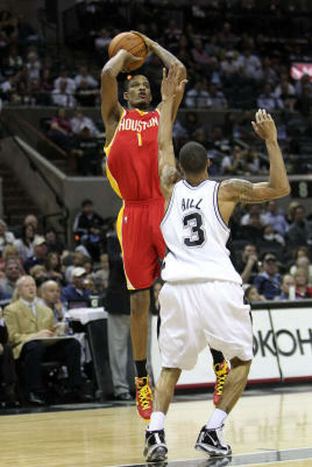 Trevor Ariza buries a shot over the Spurs' George Hill in the Rockets 116-109 road victory. Photo: Ronald Martinez, Getty Images