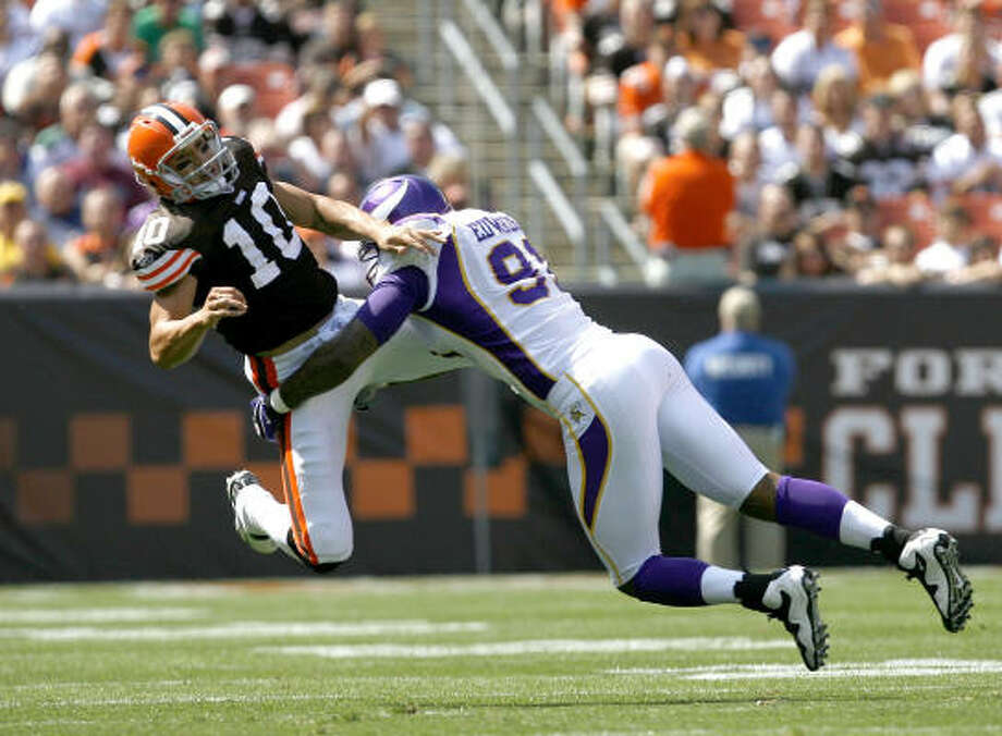 Minnesota Vikings 34, Cleveland Browns 20Vikings defensive end Ray Edwards, right, hits Browns quarterback Brady Quinn during the third quarter at Cleveland Browns Stadium. Photo: Matt Sullivan, Getty Images