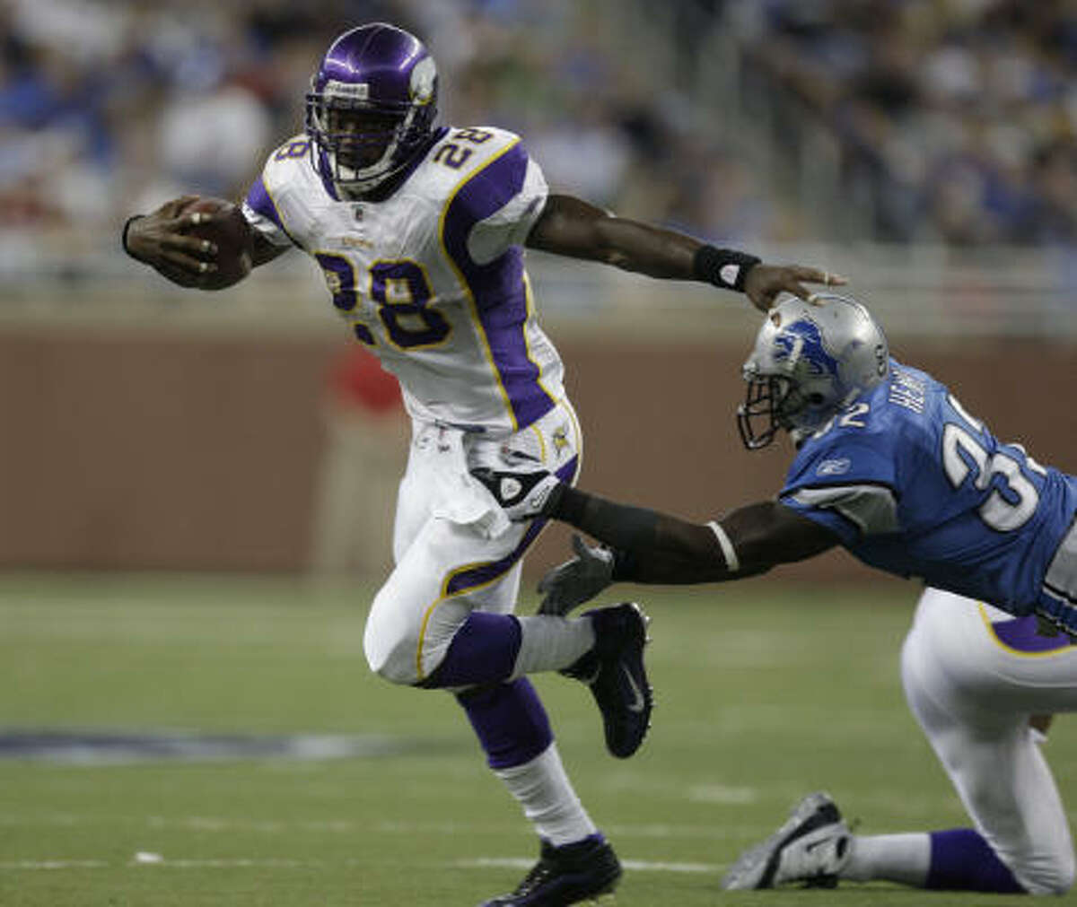 Vikings 27, Lions 13 Vikings running back Adrian Peterson breaks a tackle by Detroit's Anthony Henry and sprints to the end zone for a touchdown in the third quarter.