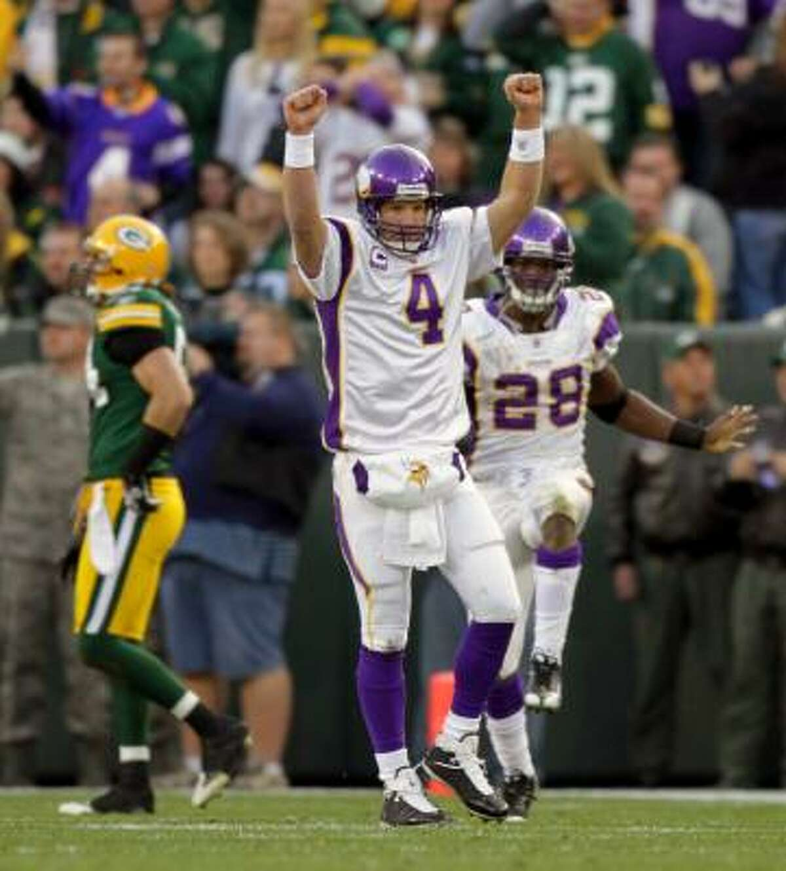 Nov. 1: Vikings 38, Packers 26 Vikings quarterback Brett Favre (4) threw for 244 yards and four touchdowns in his return to Lambeau Field.