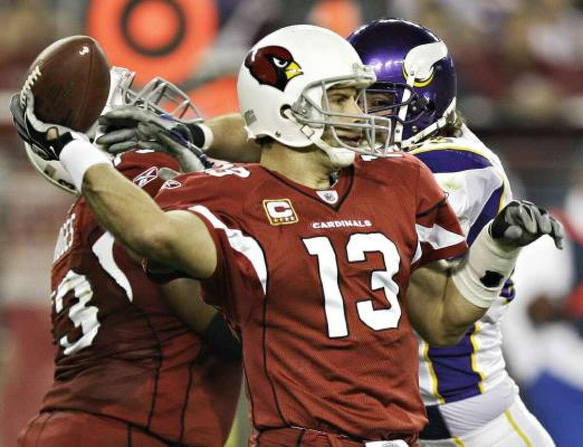 Cardinals 30, Vikings 17 Cardinals quarterback Kurt Warner threw for 285 yards and three scores against the Vikings.