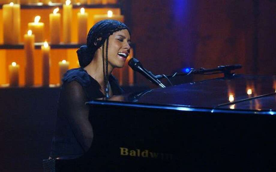 America: A Tribute To Heroes was a telethon event committed to raising money for victims of Sept. 11. George Clooney put together the widely-aired event and included performances by Bruce Springsteen, U2 and Alicia Keys (pictured). Clooney also gathered multiple stars, from Jack Nicholson and Tom Cruise to Julia Roberts, to handle the phones — and speak directly to donors. Photo: KEVIN MAZUR, AP