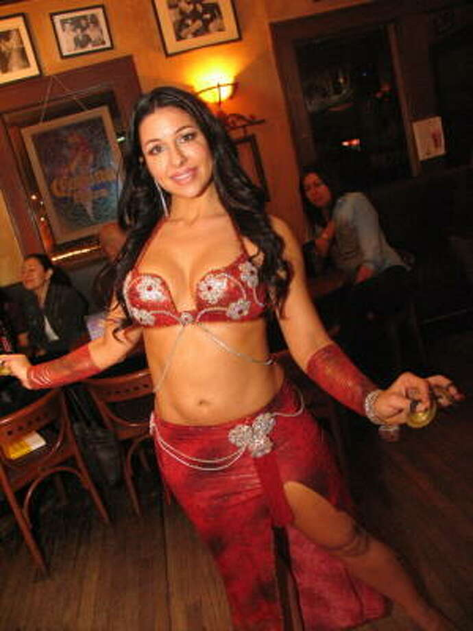 Byzantio is a popular Greek cafe by day and a bar featuring belly dancing and hookah at night. Pictured: Nicole H. Photo: Jordan Graber, For The Chronicle