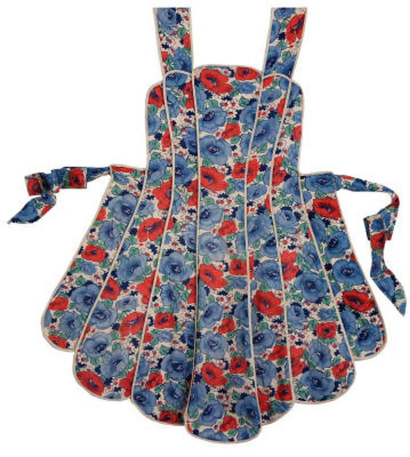 Aprons are in vogue. The garment that began as the fajita of clothing, pulled together from leftover fabric, matured into a fashion statement in the '50s.  This one is from The Apron Book, $16.95, Andrews McMeel. Photo: The Apron Book