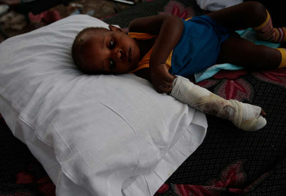 The earthquake that destroyed Port-au-Prince also had a traumatic effect on the country's needy, poor and malnourished children, like this young boy, who's recovering in a makeshift hospital. Photo: Chris Hondros, Getty Images