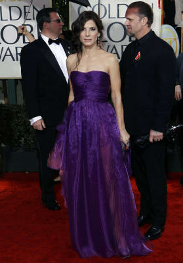 Purple is definitely Sandra Bullock's color. This  strapless gown is by Bottega Veneta's Spring/Summer 2010 collection and she's carrying Bottega Veneta's Grape Knot clutch. Photo: Matt Sayles, AP