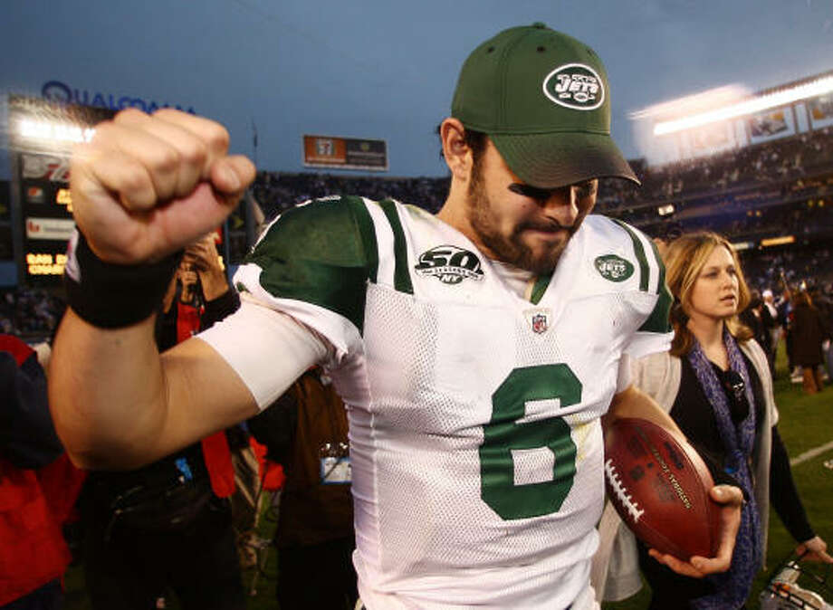 Jan. 17: Jets 17, Chargers 14 Jets quarterback Mark Sanchez walks off the field after the win over the Chargers. Photo: Donald Miralle, Getty Images