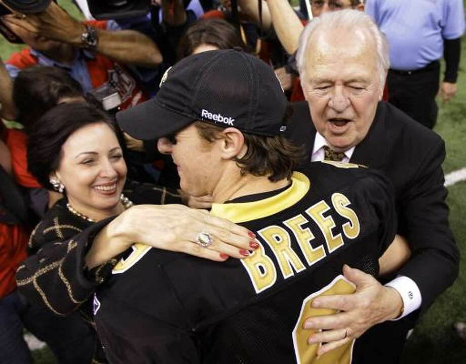 Saints owner Tom Benson, right, and his wife, Gayle, chat with quarterback Drew Brees after New Orleans' win. Photo: David J. Phillip, AP