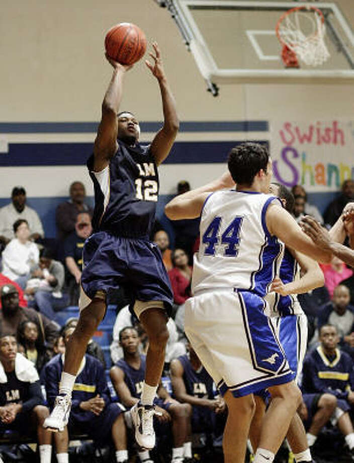 La Marque's Julien Lewis scored a game-high 20 points in the Cougars' 60-43 win over Friendswood. Photo: Bob Levey, For The Chronicle