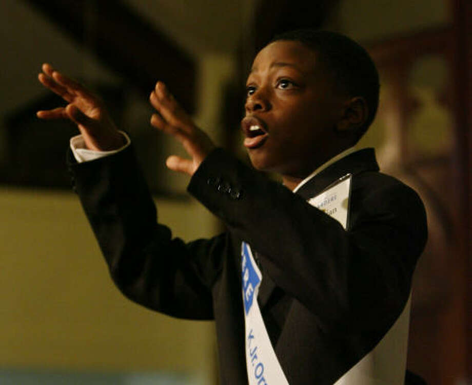 Christian Burgs, a fifth-grader at Garden Villas Elementary, captivates the audience with a lesson in how King inspired him to reach new heights. Watch Christian's and his competitors' speeches here. Photo: Karen Warren, Chronicle
