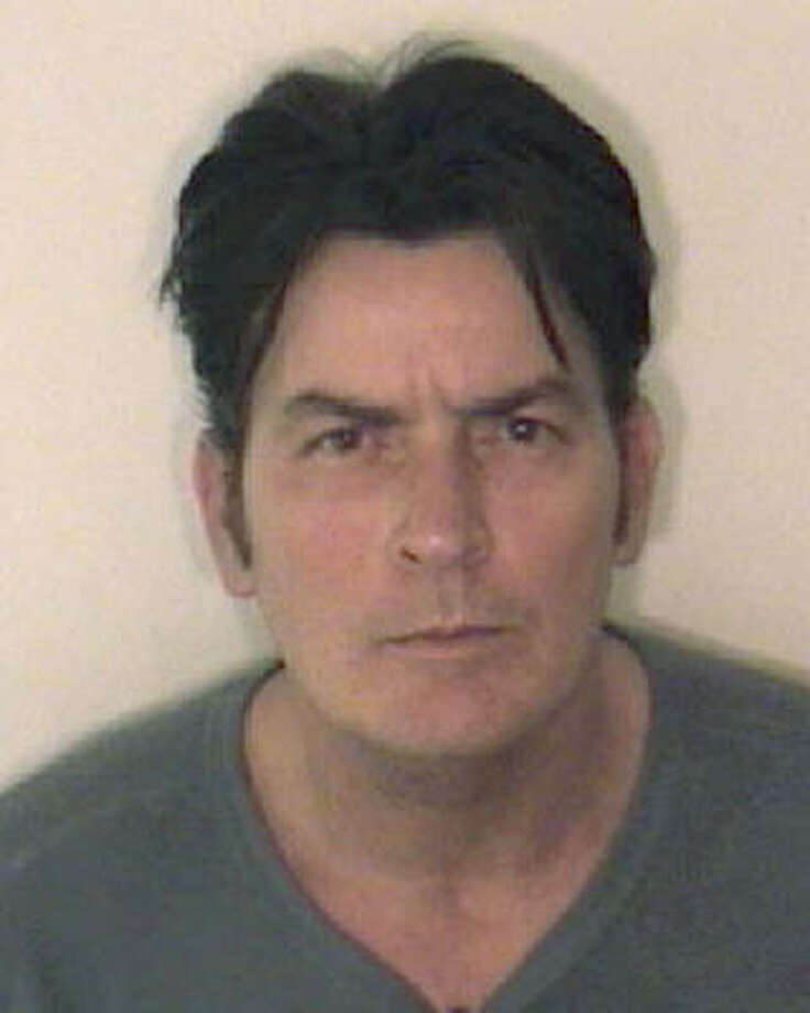 On Christmas Day, Charlie Sheen was arrested on charges related to an alleged case of domestic violence against his wife, Brooke Muller in Aspen, Colo. Take a look at other celebrities that have had a run-in with the law. Photo: AP