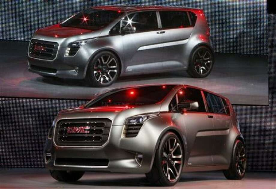 GMC introduced its Granite concept truck at the North American International Auto Show Monday. It's a cross between a panel truck and a minivan that GM says is loaded with electronics and features that appeal to young professionals. Photo: AP