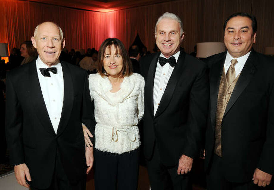 Honorees Bill and Andrea White with co-chairs Mark Wallace and Massey Villarreal at the Opportunity Ball raising scholarship funds for Houston Community College students. Photo: Dave Rossman, For The Chronicle