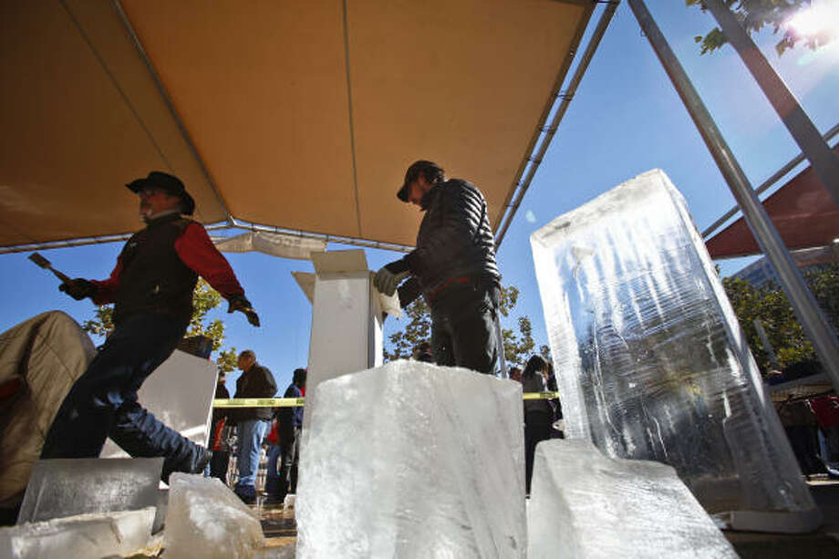 Scott Nagel and his assistant Daniel Crumbaker unpack ice blocks before transforming them into a massive grasshopper during the Magnificent Seven All Out Ice Sculpting Competition. Seven of the best ice sculptors in the world visited Discovery Green to battle for bragging rights and a cash grand prize. Photo: Michael Paulsen, Chronicle