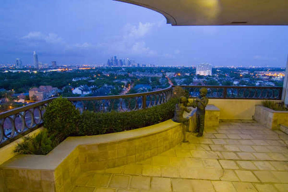 This landscaped balcony, off the den and dining room, overlooks downtown. Another balcony off the master suite overlooks River Oaks to the Galleria. Photo: Martha Turner Properties