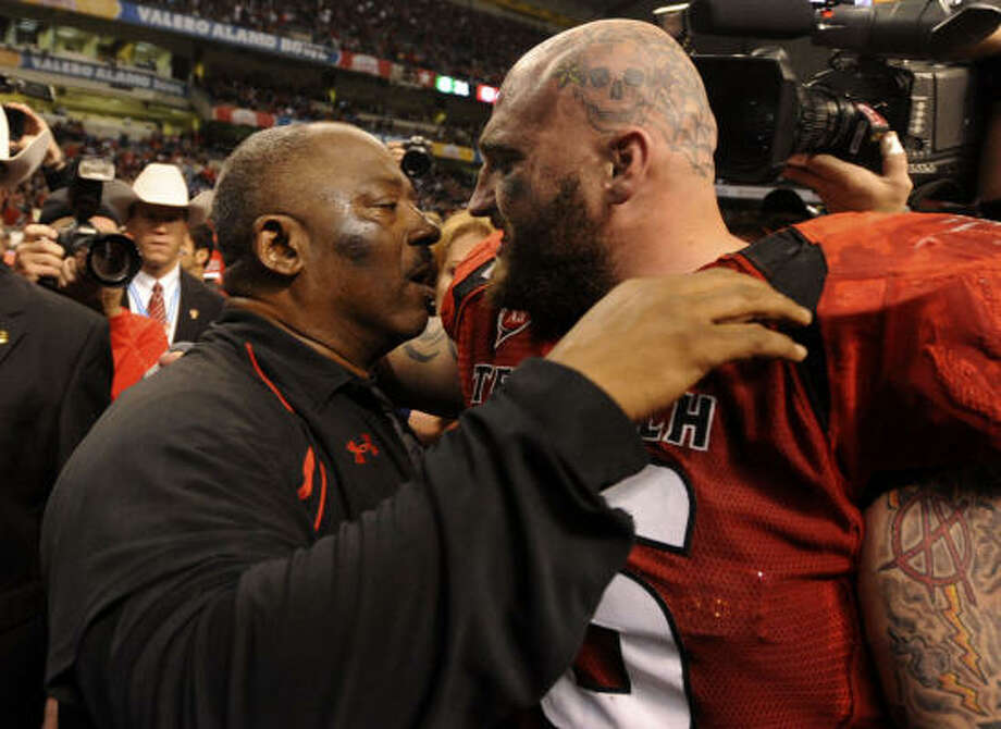 Jan. 2, Alamo Bowl: Texas Tech 41, Michigan State 31 Texas Tech interim head coach Ruffin McNeill embraces Brandon Carter after defeating Michigan State. McNeill took over after former coach Mike Leach was fired Wednesday. Photo: BILLY CALZADA, SAN ANTONIO EXPRESS-NEWS