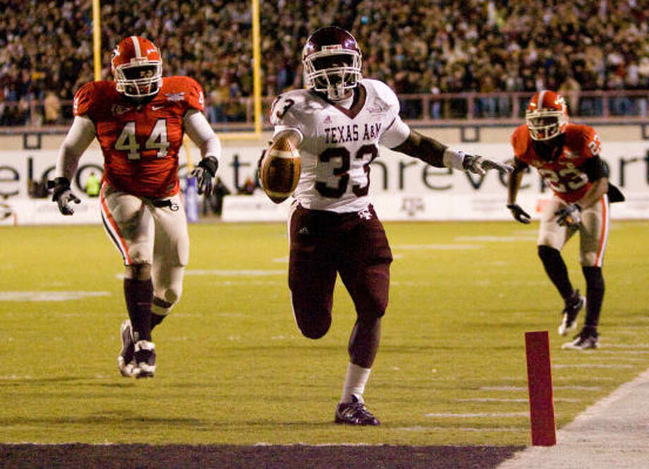 Texas A&M running back Christine Michael rushed for 77yards and a touchdown, but it wasn't enough to prevent the Aggies from suffering a 44-20 loss to Georgia in the Independence Bowl on Monday night in Shreveport, La. Photo: Nick De La Torre, Chronicle