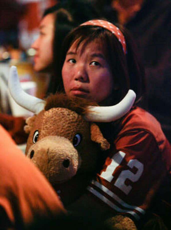 With Texas quarterback Colt McCoy out of the game, Vienna Lei sits upset while watching Thursday night's BCS title game between Texas and Alabama at a Texas Ex watch party at Lucky's Pub in Houston. Photo: Billy Smith II, Chronicle