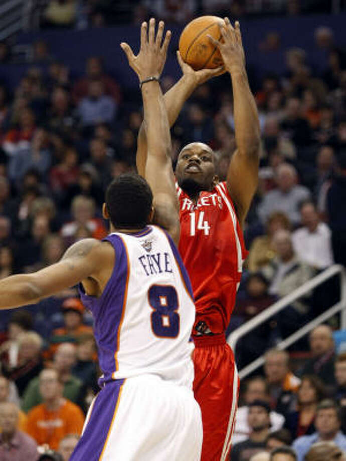 Jan. 6: Suns 118, Rockets 110Rockets forward Carl Landry shoots over the Suns' Channing Frye during the first half. Photo: Matt York, AP