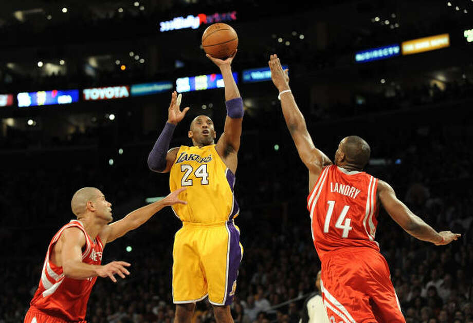 Jan. 5: Lakers 88, Rockets 79Lakers guard Kobe Bryant shoots a jumper over the Rockets' Carl Landry, right, and Shane Battier during the first half. Photo: Harry How, Getty Images