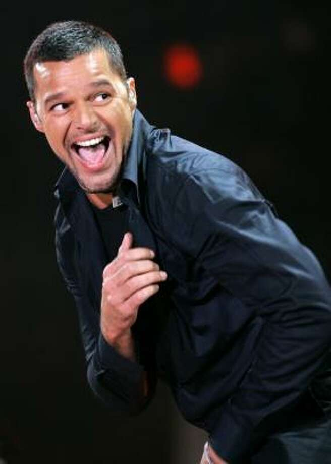 Ricky Martin is a father to twin boys who were conceived and carried by a surrogate mother. Photo: Miguel Tovar, AP