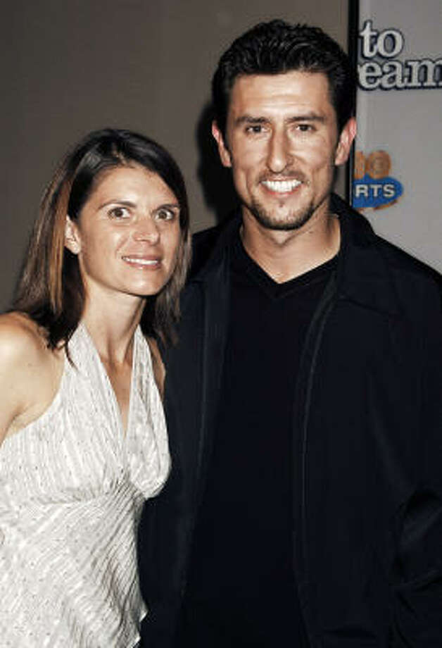 Mia Hamm and Nomar Garciaparra are parents to twin girls. Photo: LOUIS LANZANO, AP