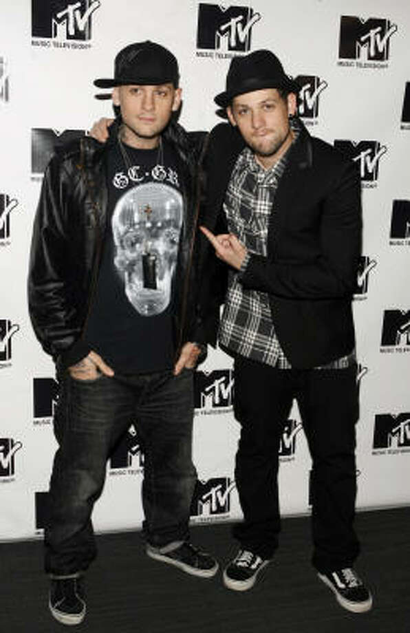 Benji, left, and Joel Madden of the band Good Charlotte are twin brothers. Photo: Jason DeCrow, AP
