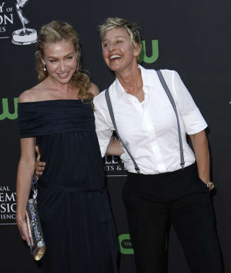 Ellen DeGeneres and Portia de Rossi: They were voted the most popular celebrity couple in a poll, but this power couple are in league with some big names. Photo: Matt Sayles, AP