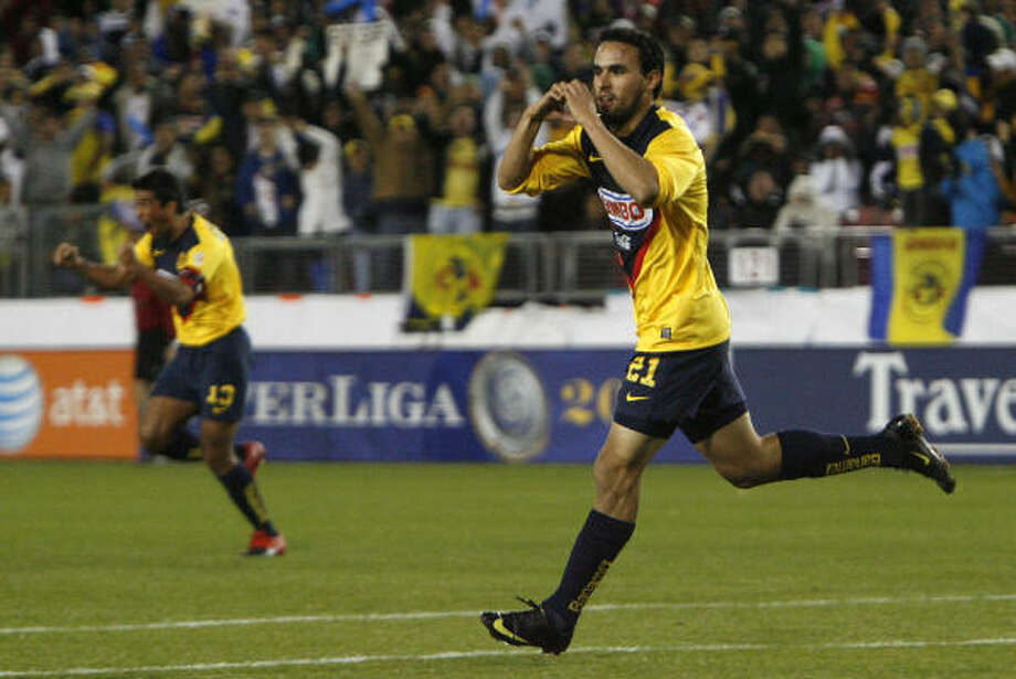 Club America forward Enrique Alejandro Esqueda gestures a heart with his hand as he celebrates his first-half goal that gave Club America a short-lived 1-0 lead in the first half of Saturday's Interliga matchup against Santos at Robertson Stadium. Santos tied the score on a penalty kick by Juan Pablo Rodriguez., but Club America went on to win 3-1. Photo: Julio Cortez, Chronicle