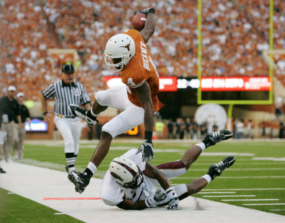 Game 1: Sept. 5 Texas 59, Louisiana-Monroe 20Texas receiver Dan Buckner leaps as he gets knocked out of bounds just short of the end zone in Austin. Photo: Brian Bahr, Getty Images