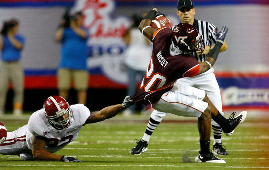 Game 1: Sept. 5 Alabama 34, Virginia Tech 24Virginia Tech cornerback Jayron Hosley tries to break a tackle by Alabama's Eryk Anders in Atlanta. Photo: Kevin C. Cox, Getty Images