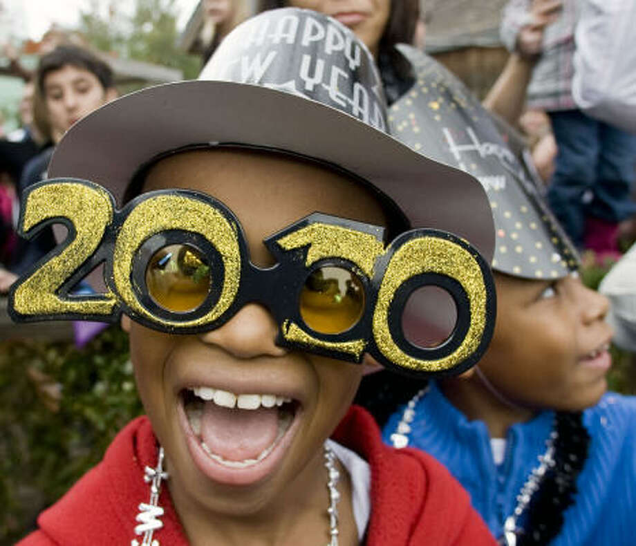 "Ricardo Banks, left, 9, and Joshua Pryor, 7, ring in the new year early at the Houston Children's Museum's ""New Year's Noon Bash."" Photo: James Nielsen, Chronicle"