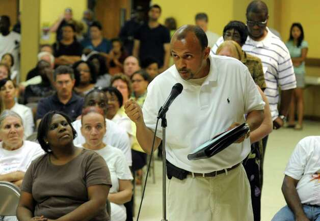 Acting Commissioner of Education George Coleman held another meeting with the public, this time at Mount Aery Baptist Church in Bridgeport, Conn. on Wednesday July 13, 2011. Concerned parent John Gomes asks Commissioner Coleman a question. Photo: Christian Abraham / Connecticut Post