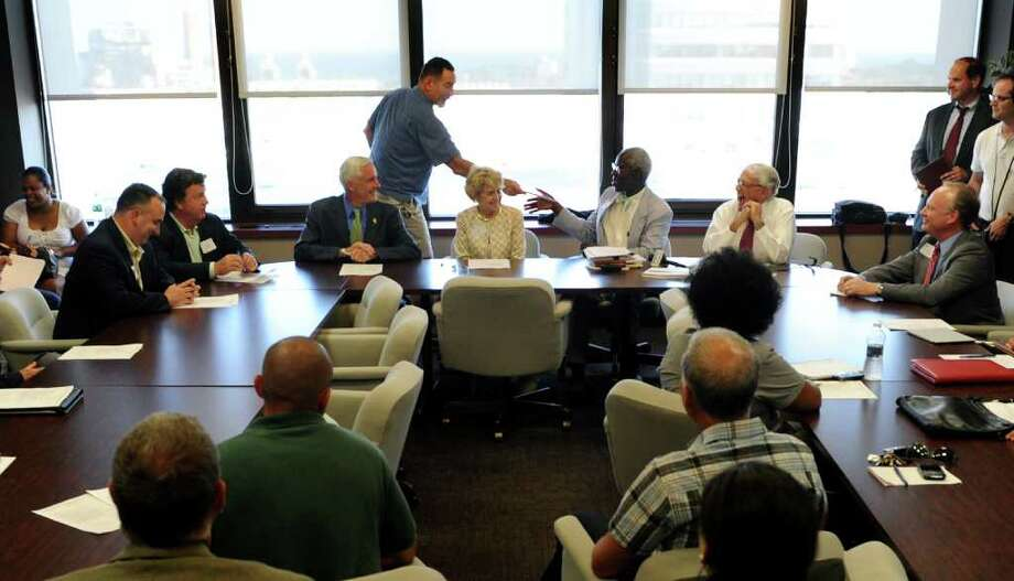Blackham School teacher Chris Kinsley hands his resume to Acting Commissioner George Coleman to let him know he's ready to step up and help as part of the new board of education, before Coleman speaks to members of the Bridgeport Regional Business Council in Bridgeport on Tuesday July 12, 2011. Coleman has been tasked to pick a replacement Board of Education for Bridgeport. Photo: Christian Abraham / Connecticut Post