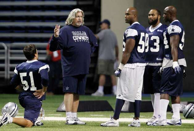 Dallas Cowboys defensive coordinator Rob Ryan, second from left, talks with Keith Brooking (51), Bradie James (56), Anthony Spencer (93) and DeMarcus Ware, right,  during NFL football training camp, Friday, July 29, 2011, in San Antonio. Photo: AP