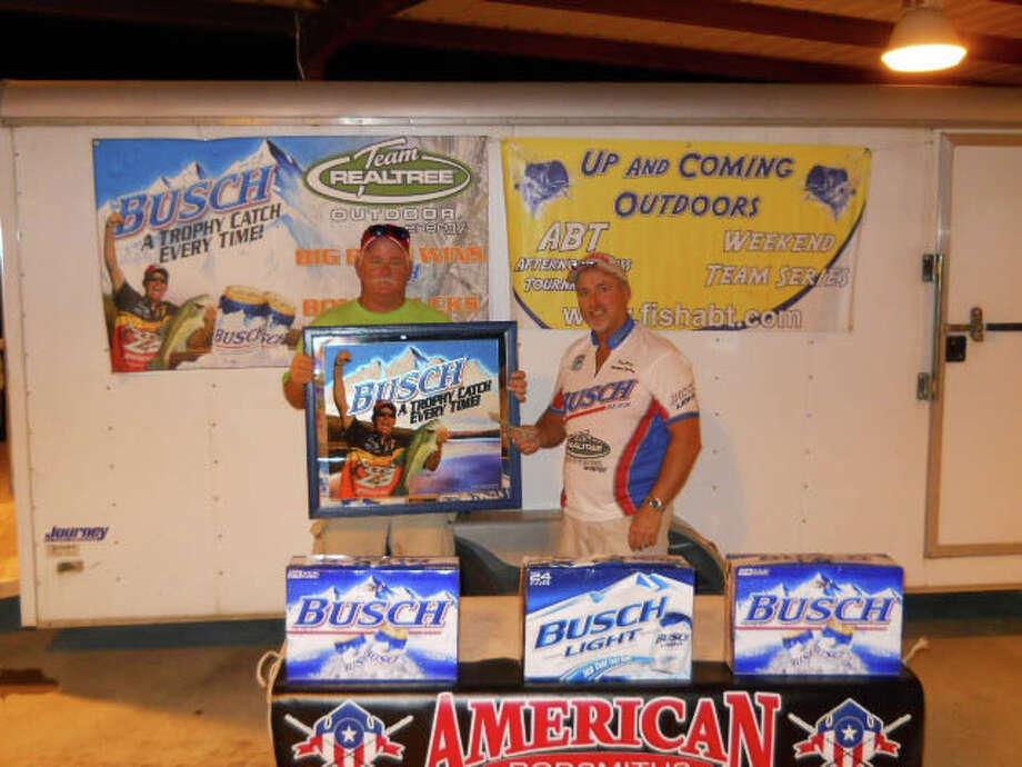 Robert Newlan presents Tony Coburn with the $200.00 Busch Bonus Bucks and a KVD Mirror