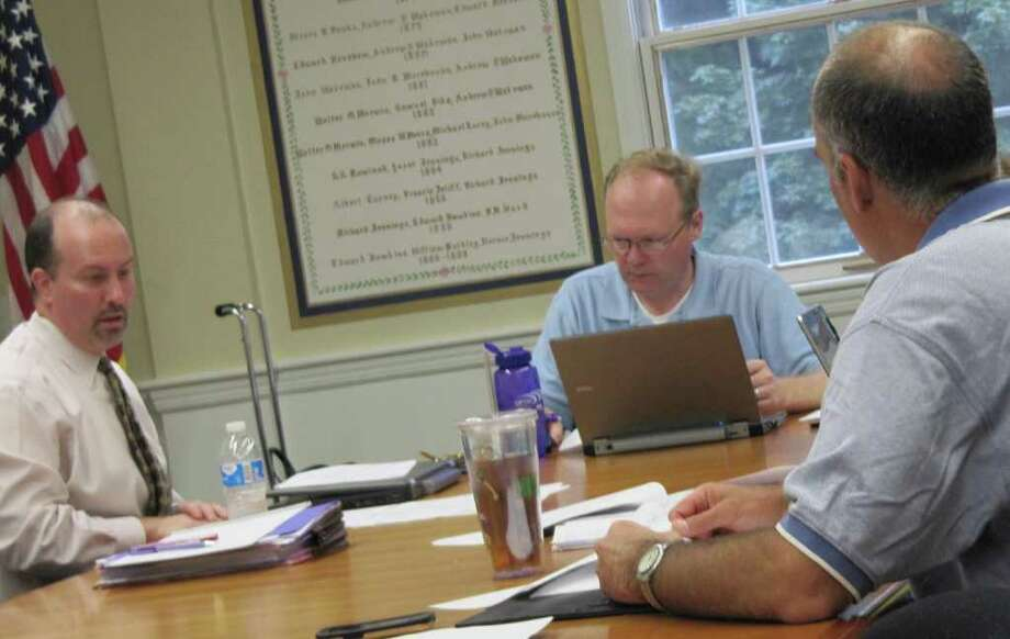 A Board of Finance subcommittee on Wednesday continued to work on the planned audit of the Fairfield Metro Railroad Station cost overruns. From left are: Joseph Centofanti, a partner with the Farmington-based audit firm Kostin, Ruffkess & Co., LLC; Kevin Kiley, the subcommittee chairman, and subcommittee member Kenneth Brachfeld. Photo: Kirk Lang / Fairfield Citizen