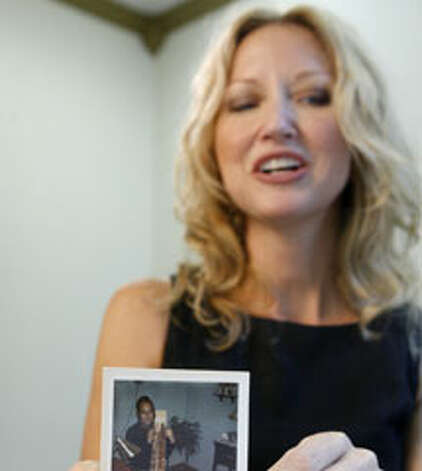 Marla Cooper with a photo of her uncle, L.D. Cooper. (Associated Press photo)